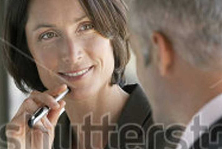 1920-happy-businesswoman-listening-to-male-colleague-in-office-146565941